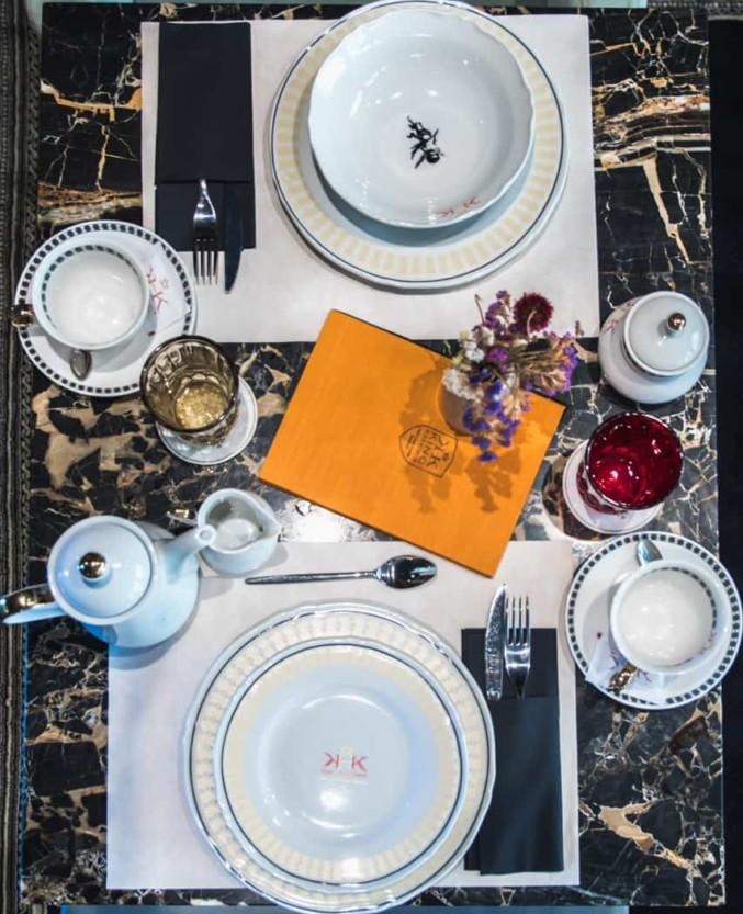 King Krešimir Heritage Hotel restaurant in old city center Šibenik, plates on marble table