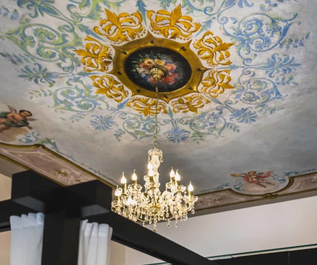 Unique hand painted fresco ceiling in the room of King Krešimir Heritage Hotel, Šibenik