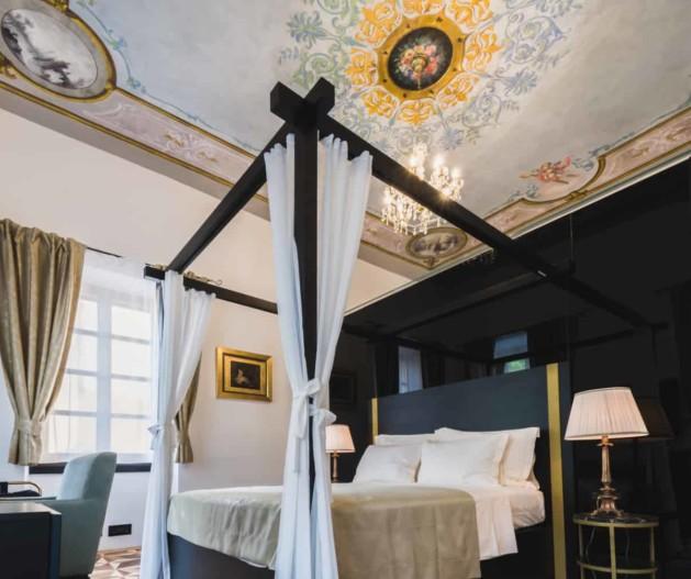 King Krešimir Heritage Hotel luxury black and gold room, fresco ceilings