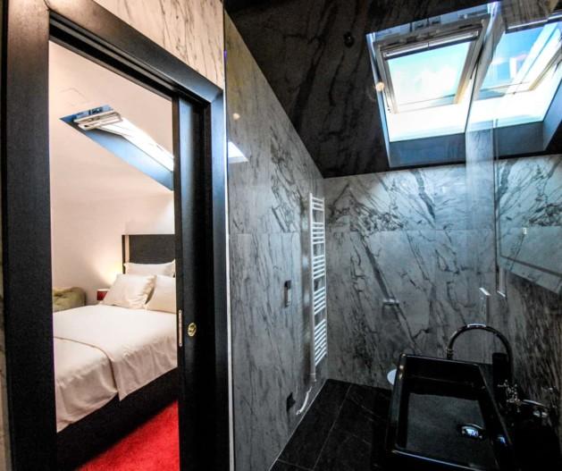 Marble bathroom with black details and roof window in Superior room King Krešimir Heritage Hotel, Šibenik