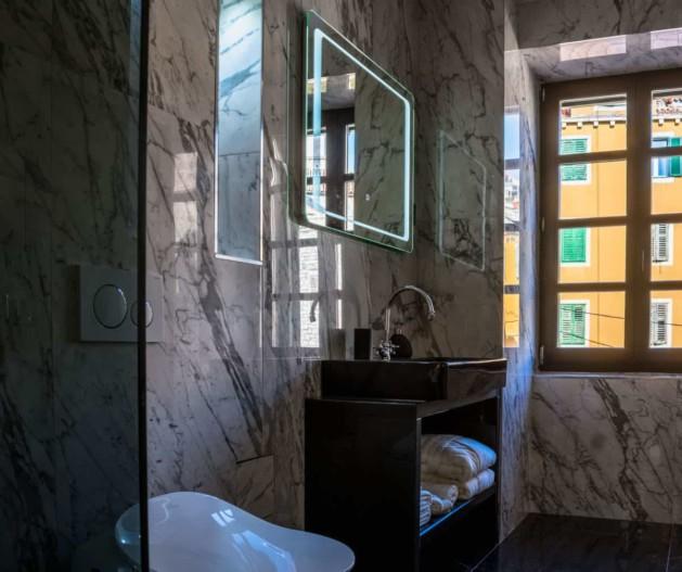 Marble bathroom and walk in shower with black details and window view in Superior room King Krešimir Heritage Hotel, Šibenik
