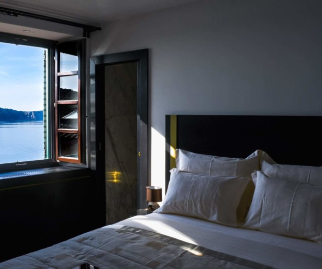Sea view from room window, morning sunshine on comfy bed in King Krešimir Heritage Hotel, Šibenik