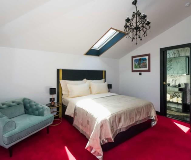 Modern design of Superior room at top floor of King Krešimir Heritage Hotel, black details and black chandelier in a bedroom