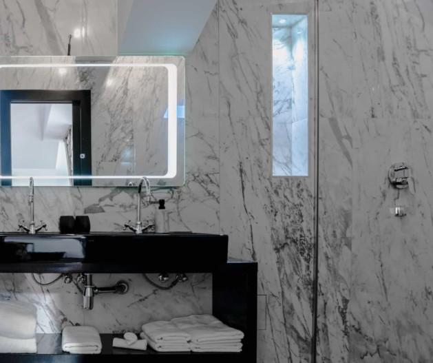Marble bathroom with black details and mirror in Superior room King Krešimir Heritage Hotel, Šibenik