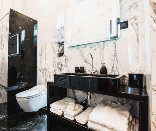 Marble bathroom with black sink and walk in shower in Superior suite King Krešimir Heritage Hotel, Šibenik